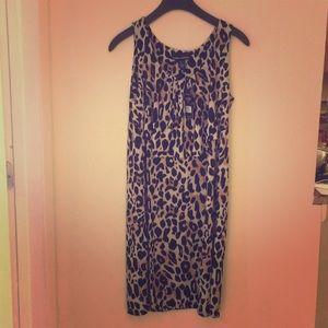 An Knee length leopard print dress.